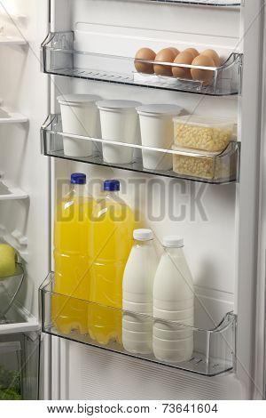 Opened Refrigerator Full Of Foodstuff And Drinks