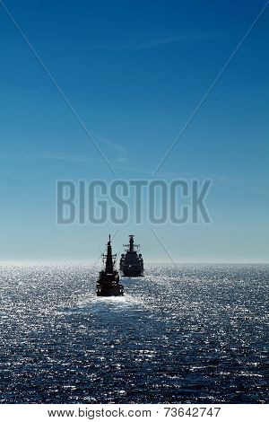 Navy ships during a clear day