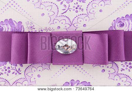 Violet bow with gem.