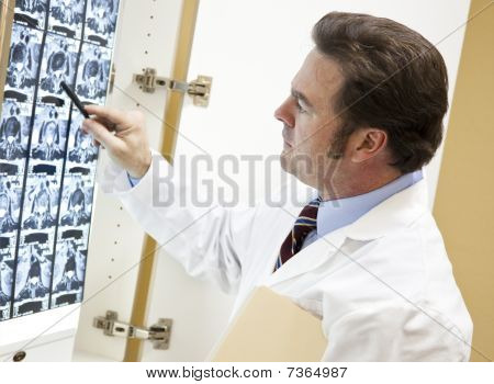 Chiropractor Examines Ct Scan
