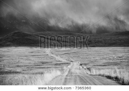 Storm Cloud Passing Through A Barren Mountain Landscape
