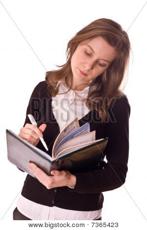 young women writting in a book.