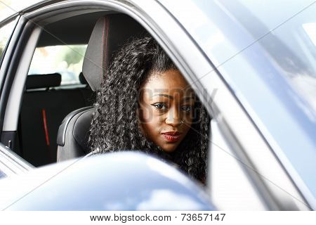 Attractive Stylish African Woman Driving A Car