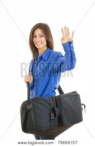Pretty Fashionable Woman With Large Suitcase Waving