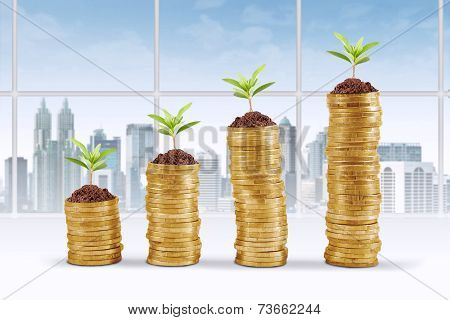 Pile Of Coins And Tree In Office