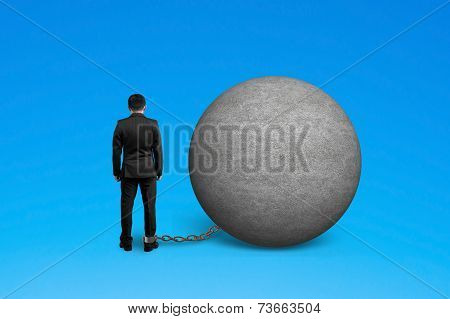 Man Being Trapped With Concrete Ball