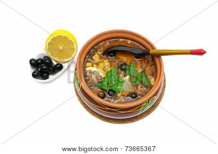 Soup Thistle, Olives And Lemon Isolated On A White Background