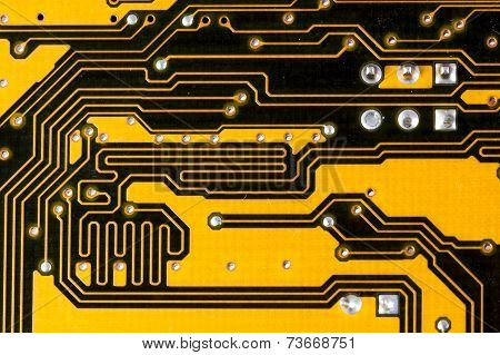 Black and yellow pcb circuit of motherboard.