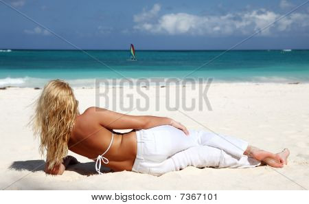 Young Woman  Enjoying The Day At The Caribbean Beach