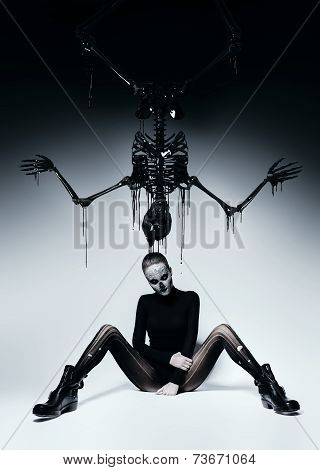 Dark Woman With Skull Face And Black Skeleton