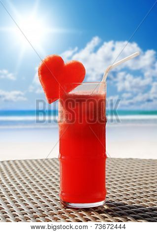 Fruity cocktail on a beach table