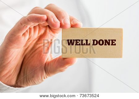 Man Holding Small Piece Wood Showing Well Done Text