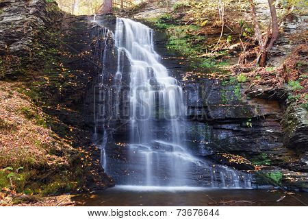 Autumn Waterfall in mountain with foliage. Bridesmaid Falls from Bushkill Falls, Pennsylvania.