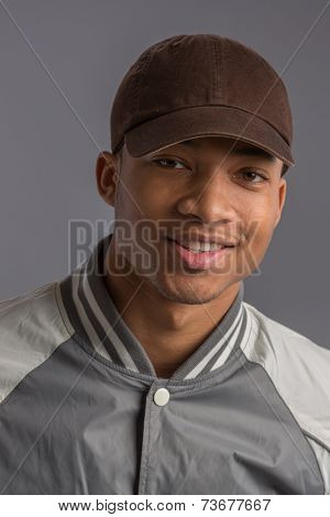 Young African American Male Low Key Portrait on Blue Background