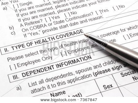 Health Insurance Application With Pen