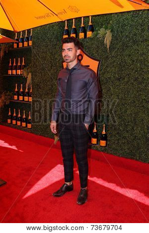 LOS ANGELES - OCT 11:  Joe Jonas at the Fifth-Annual Veuve Clicquot Polo Classic at Will Rogers State Historic Park on October 11, 2014 in Pacific Palisades, CA