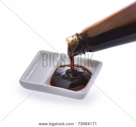 Oyster sauce poured from a bottle