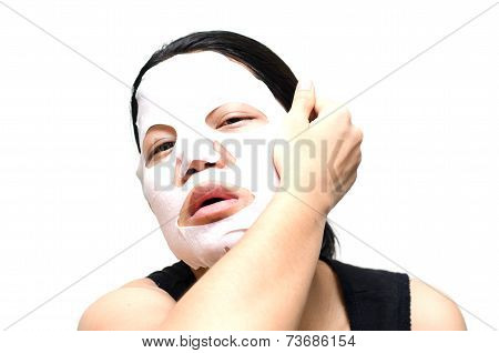 Woman Taking Off Facial Mask On Face