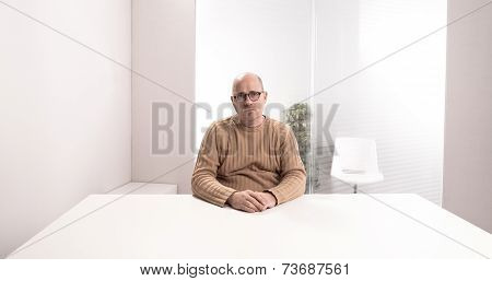 Sad Office Worker In An Empty Room