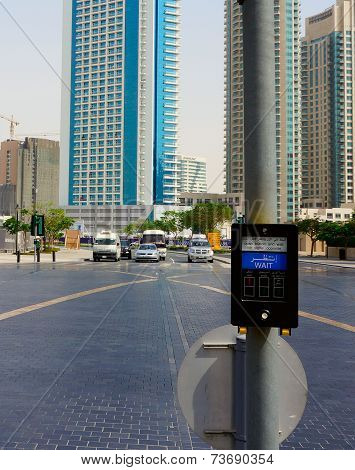 Sharjah, United Arab Emirates - April 22: The button on the pedestrian crossing on the background