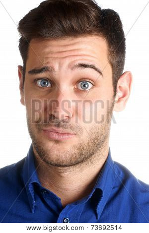 Young Man Making A Funny Face Over A White Background