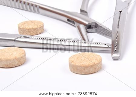 Forceps And Tablets
