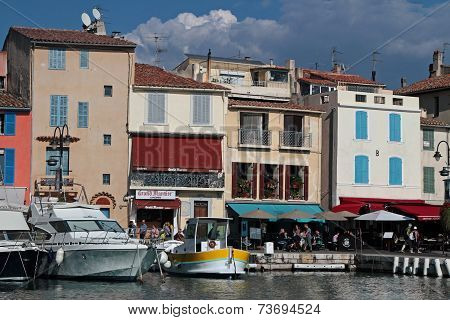 Cassis, France, October 3, 2014 : Small Fishing Boats Wait In The Harbor Of Cassis. The Newly Declar