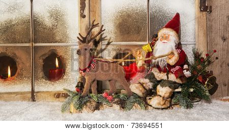 Classical christmas decoration: santa claus riding on reindeer buying gifts.