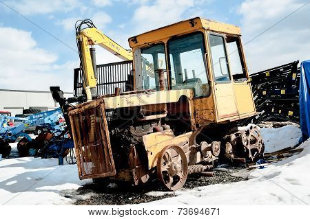 Old tractor among new equipment. Tyumen. Russia