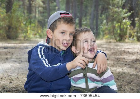 Brother In The Woods, Hugged His Little Sister, And Something Tells Her, She Laughs.