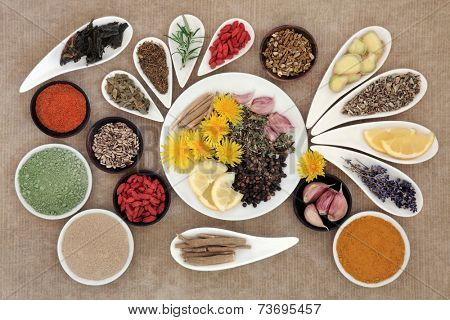 Immune boosting healthy superfood selection in porcelain dishes over brown  background.