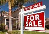 stock photo of yard sale  - Short Sale Home For Sale Real Estate Sign and House  - JPG