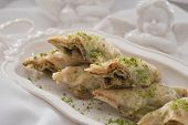 stock photo of baklava  - A close up of baklava with pistachios and walnuts - JPG