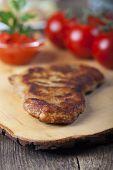 picture of wieners  - wiener schnitzel on a wooden board with tomatos  - JPG