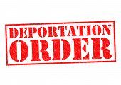 stock photo of eviction  - DEPORTATION ORDER red Rubber Stamp over a white background - JPG