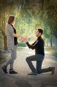 stock photo of marriage proposal  - Man proposing marriage with a romantic gesture - JPG