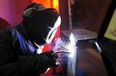 pic of tig  - worker Cutting metal with mig welder in construction site - JPG