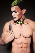 picture of beast-man  - fashion studio photo of sexy muscular man with naked chest with painted face for Halloween party - JPG