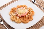 image of shredded cheese  - waffle with sausace topping with shred cheese - JPG