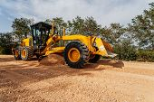stock photo of motor vehicles  - Road making construction site with motor grader - JPG
