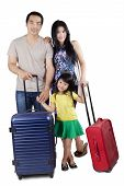 picture of carry-on luggage  - Happy asian family carrying luggage and ready to holiday isolated over white background - JPG