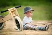 picture of tricycle  - Little boy with wooden tricycle in nature - JPG