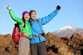 stock photo of canary-islands  - Happy celebrating winning hiking people at top - JPG