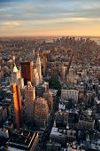 stock photo of skyscrapers  - New York City Manhattan sunset skyline aerial view with office building skyscrapers and Hudson River - JPG