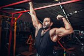 pic of muscle builder  - Body Builder Working Out At Gym - JPG