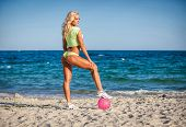 picture of volleyball  - Beach woman in bikini holding a volleyball - JPG