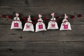 image of christening  - Presents with hearts hanging on wooden background for birthday - JPG
