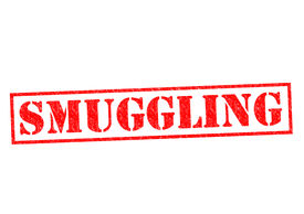 foto of smuggling  - SMUGGLING red Rubber Stamp over a white background - JPG