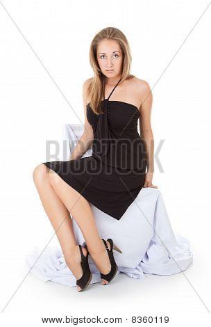 Scared Beautiful Girl Sitting On Chair