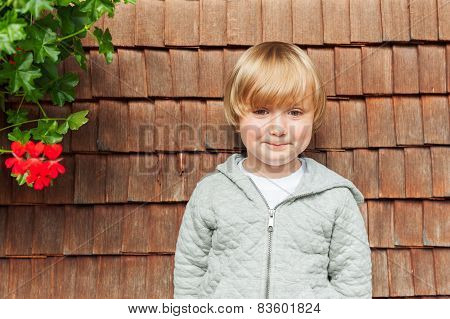 Outdoor portrait of adorable little boy